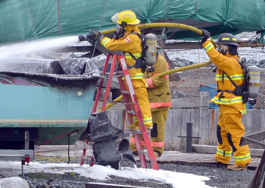 <p>KEITH CORCORAN, PHOTO</p><p>Volunteer firefighters work the scene off River Lane on September 12.</p>