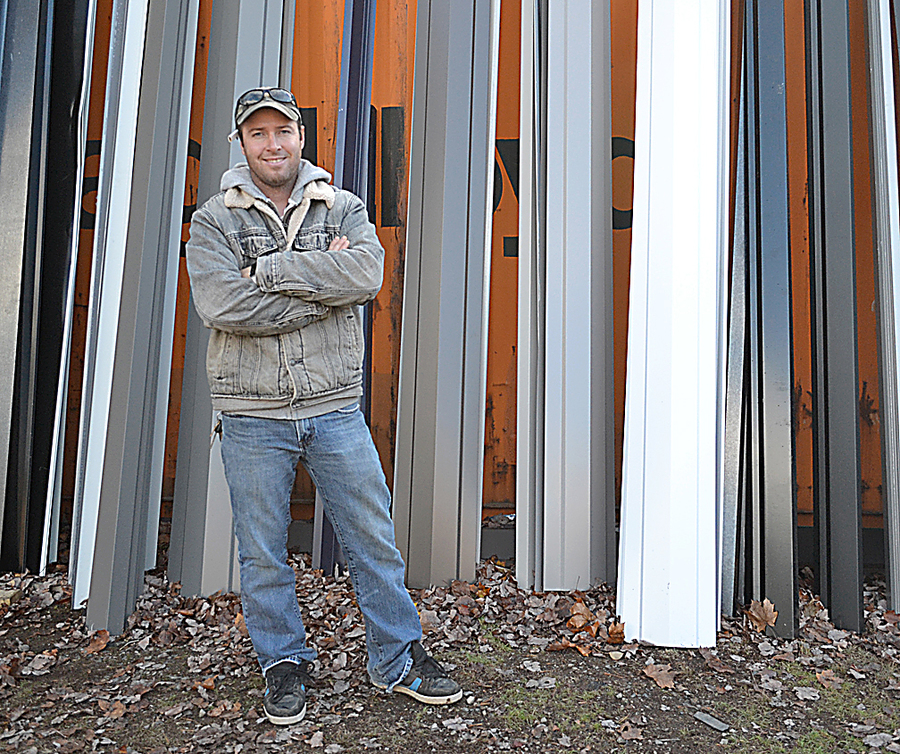 <p>GAYLE WILSON PHOTO</p><p>Johnny Wall, owner of Walls Metal Roofing, is expanding the company to include manufacturing as well as installation.</p>