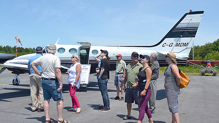 <p>GAYLE WILSON PHOTO</p><p>Small crowd gathered at the Cessna 340 owned by COPA's Atlantic director, Brian Pound, who flew in for the South Shore Flying Club's open house.</p>