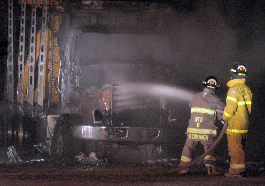 <p>KEITH CORCORAN, PHOTO</p><p>EXTINGUISHING VEHICLE FIRE</p><p>Volunteer firefighters work the scene of a tractor trailer fire late July 14 in Wileville. First responders, dispatched at 11:33 p.m., arrived at a property near the corner of Highway 325 and the Lester Getson Road to find the vehicle fully ablaze. Emergency crews worked the scene for about two hours. No other information about the incident was immediately available.</p>