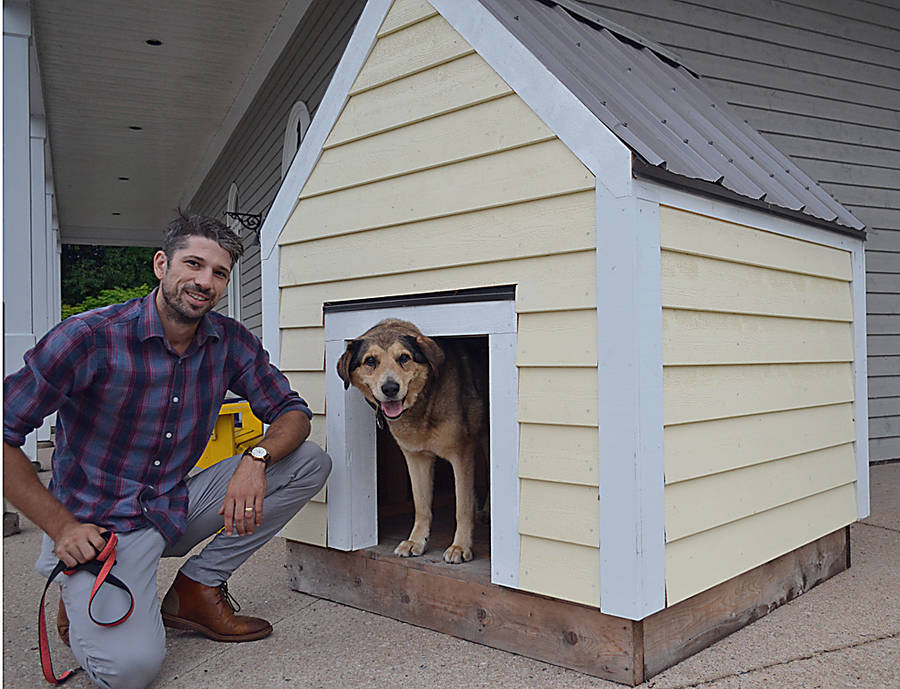 <p>GAYLE WILSON PHOTO</p><p>Tilia's Liam Finney and his dog Hank at the dog house outside South Shore Veterinary Hospital to be raffled off October 1, with proceeds going to Elderdog.</p>
